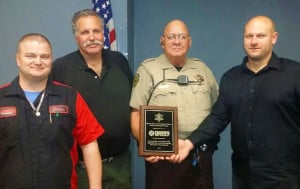 Champs received a plaque in recognition for their work on the Maricopa County Sheriff's Office's vehicles.